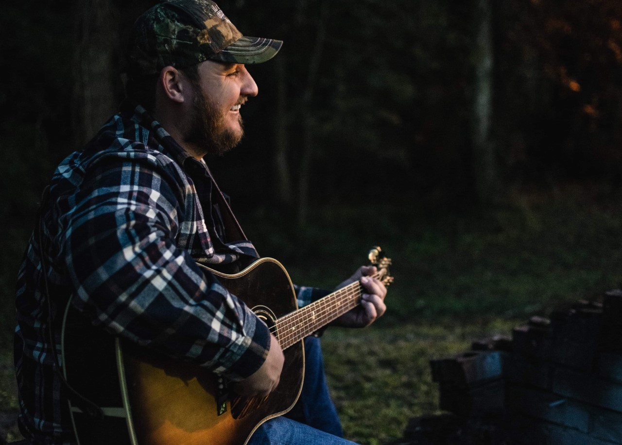 Clay Booker performing at Aunt Mom's Day on the Farm